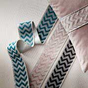 Coloured ribbon around a pillow